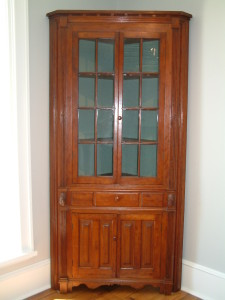 440 - 1 piece, 16 light (2 x 8) Cherry Corner Cupboard attributed to Butler County Ohio